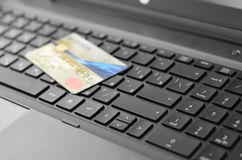 Credit card and laptop Royalty Free Stock Photo
