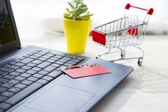 Credit card on laptop. Online shopping Stock Images
