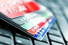 Credit card on laptop keyboard royalty free stock photo