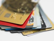 Credit card on laptop, online shoppingStack of multicolored credit cards close-up Royalty Free Stock Photography