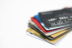 Credit card on laptop, online shoppingStack of multicolored credit cards close-up Royalty Free Stock Photo