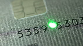 Credit card and laser Royalty Free Stock Image