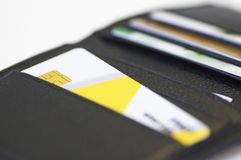 Credit card in leather wallet. On white, shallow dof