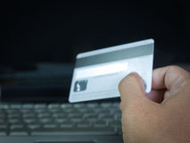 Credit card , On-line shopping. On the internet using a laptop Stock Photos