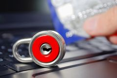 Credit card and lock on laptop. Credit card and red lock on the laptop Royalty Free Stock Photos