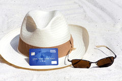 Credit card lying on the beach Royalty Free Stock Image