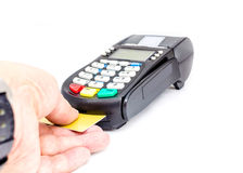 Credit card machine. Close-up of businessman hand insert credit card in credit card reader machine Stock Photography