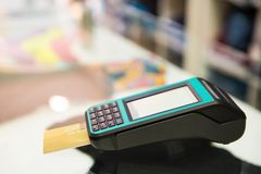 Credit card machine with bokeh background.  stock photography