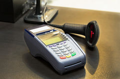 Credit Card Machine on cashier counter in the store Stock Photography
