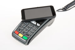 Credit card machine with code reader in smart mobile phone, Royalty Free Stock Image