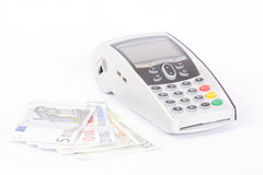 Credit card machine and euros Royalty Free Stock Photos