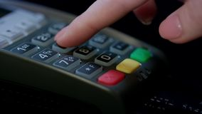 Credit card machine for money transaction. Woman hand with credit card. Swipe through pos terminal and enter pin code. Banking services of electronic money stock video