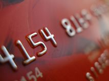 Credit card macro. Digits on red credit card macro royalty free stock images