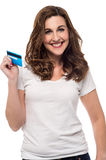 Credit card made shopping easy !. Smiling woman showing her credit card Stock Photo