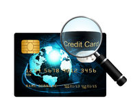 Credit card with magnifying glass over white background Royalty Free Stock Photo