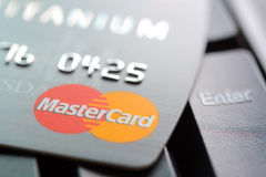 Credit card with MasterCard logo on computer keyboard Stock Image
