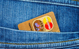 Credit card MasterCard sticking out of the back jeans pocket Stock Photos