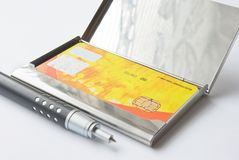 Credit Card Metallic Holder With Pen Stock Photo
