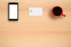 Credit card mock-up, smartphone and coffee cup Stock Photography