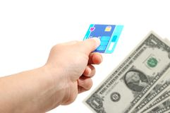 Credit card and money. Hand hold a credit card and money in background Stock Photos