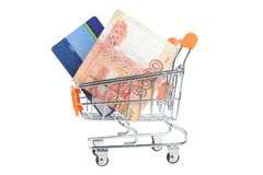 Credit card and money within shopping cart isolated on white Stock Images