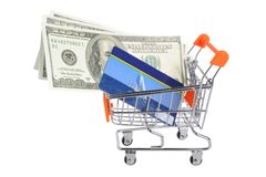 Credit card and money within shopping cart isolated on white Royalty Free Stock Photo
