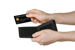 Credit card. One hands over a credit card from a wallet Stock Photo