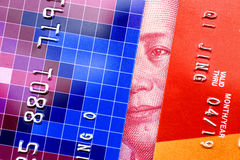 Credit card and one hundred china yuan.Maozedong peeping between two credit cards Stock Images