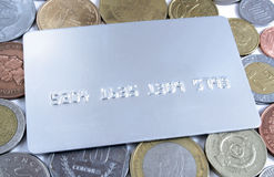 Credit card over coins. One Silver Credit card over coins Stock Images