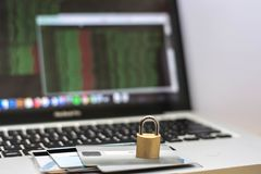 Credit card and padlock with monitor showing hacking tools royalty free stock photos