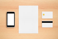 Credit card, paper sheet and cell phone Royalty Free Stock Photos
