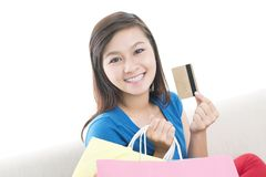 Credit card payment. Portrait of a charming girl with shopping bags and credit card stock photo