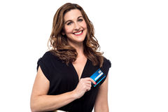 Credit card, payment made simple. Happy mid woman showing her credit card Stock Image