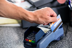Credit card payment at terminal in shop Stock Photography