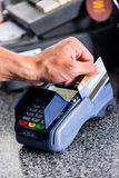 Credit card payment at terminal in shop Stock Images