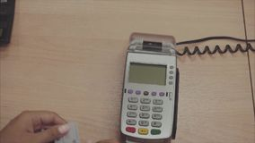 Credit card payment terminal. Transfer payment. Slow motion. stock footage