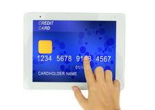 Credit card in PC tablet Royalty Free Stock Photos