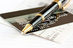 Credit card and pen Stock Images