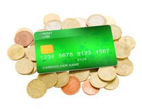 Pile of coins and plastic card royalty free stock photo