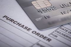 Credit card on purchase order in the office. For financial or bu Royalty Free Stock Image