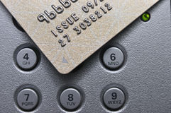 Credit card and push button Royalty Free Stock Photo