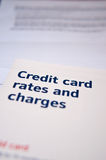 Credit card rates and charges leaflet. With some paperwork Royalty Free Stock Photography