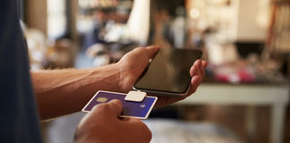 Credit Card Reading Device Attached To Mobile Phone Royalty Free Stock Image