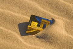 Credit card in the sand Stock Photo