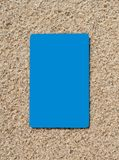 Credit card on a sand surface. Royalty Free Stock Images