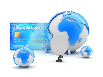 Credit card, satellite dish and earth globe Stock Photos