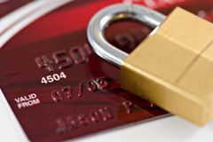 Credit Card Security. A padlock on top of a credit card with shallow depth of field stock photography