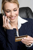 Credit Card Shopping. Blond businesswoman credit card shopping Royalty Free Stock Photos