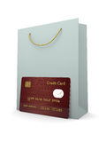 Credit card with shopping bag  over white Royalty Free Stock Images