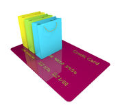 Credit card with shopping bags  over white Stock Images